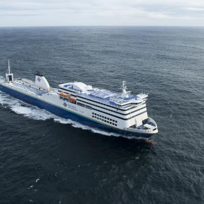 An aerial shot of a blue and white Marine Atlantic ferry as it sails in the middle of the Atlantic Ocean on a windy day.