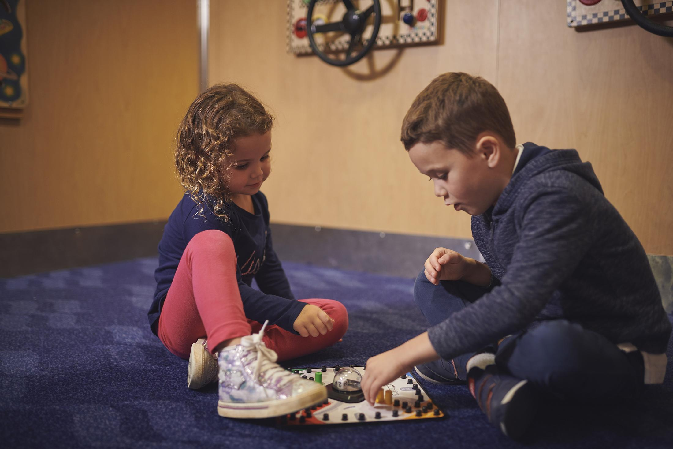 Girl and Boy Playing Board Games
