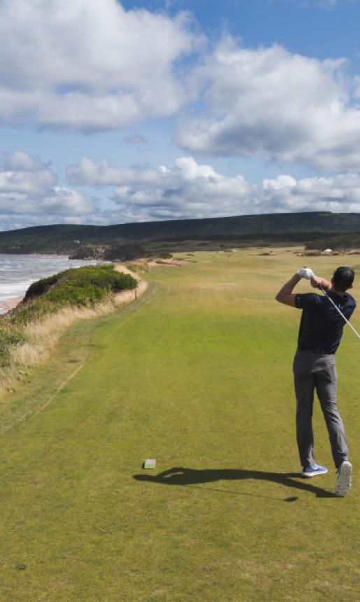 golfer along coastline of cape breton